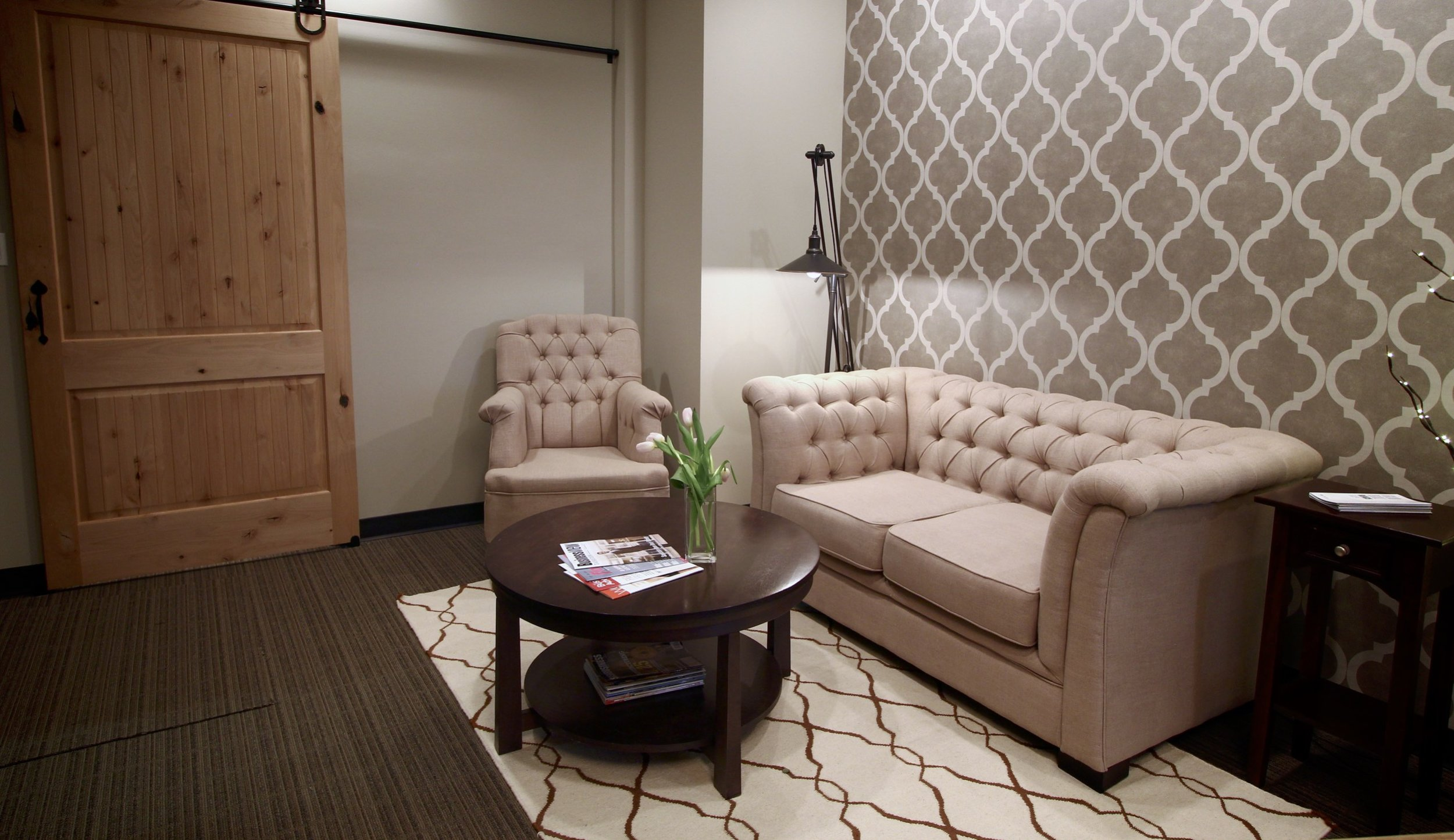 Metric Design Centre, Interior Design, Saskatoon, Commercial Design, Front Entrance, Waiting Room, Office, Rustic, Feature Wall, Barn Door, Tufted Sofa, Coffee Table, Rug.jpg