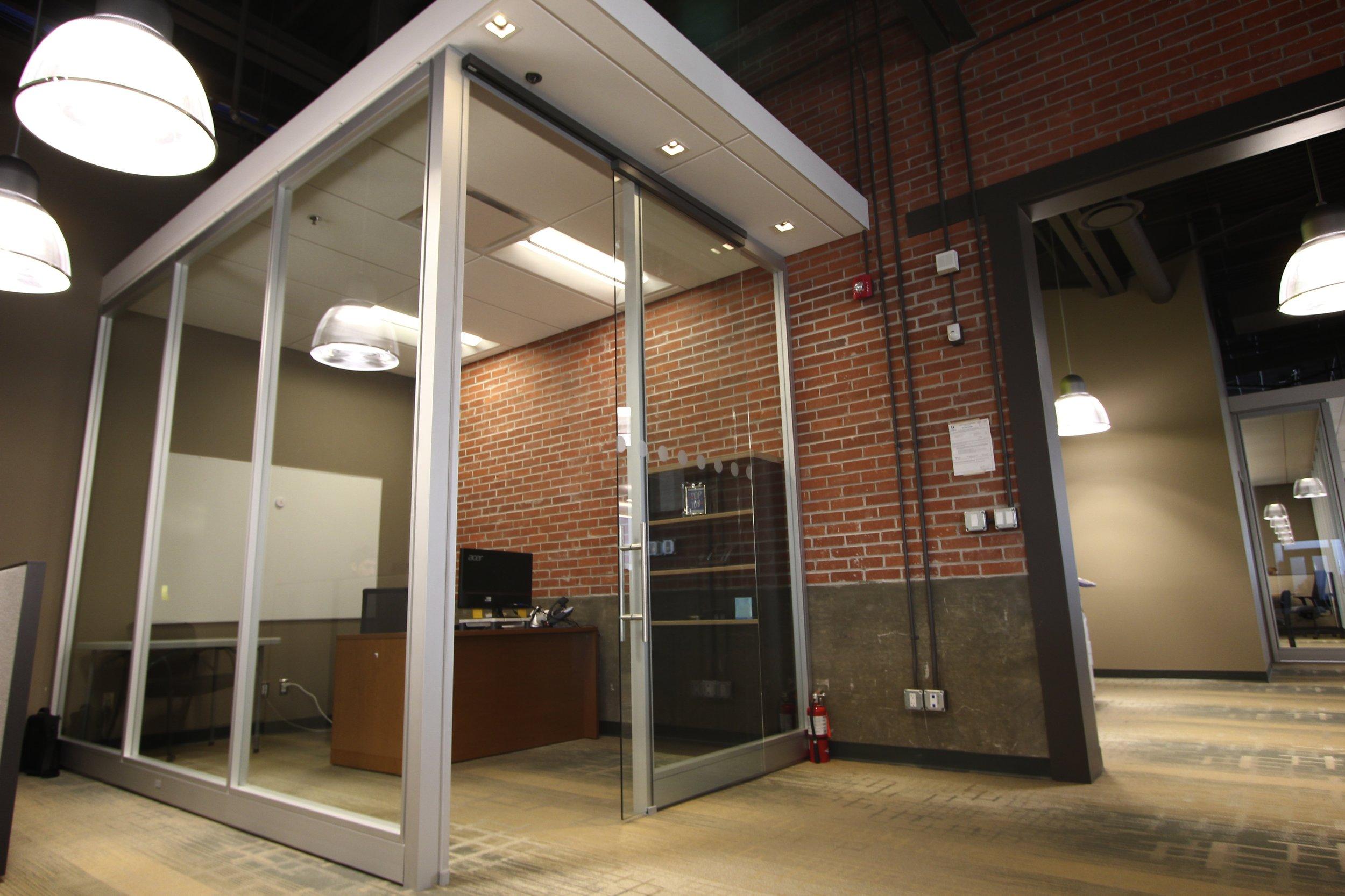 Metric Design, Saskatoon, Interior Design, Renovation, Office Partitions, Glass Partition, Exposed Brick, Pendant Lighting.jpg