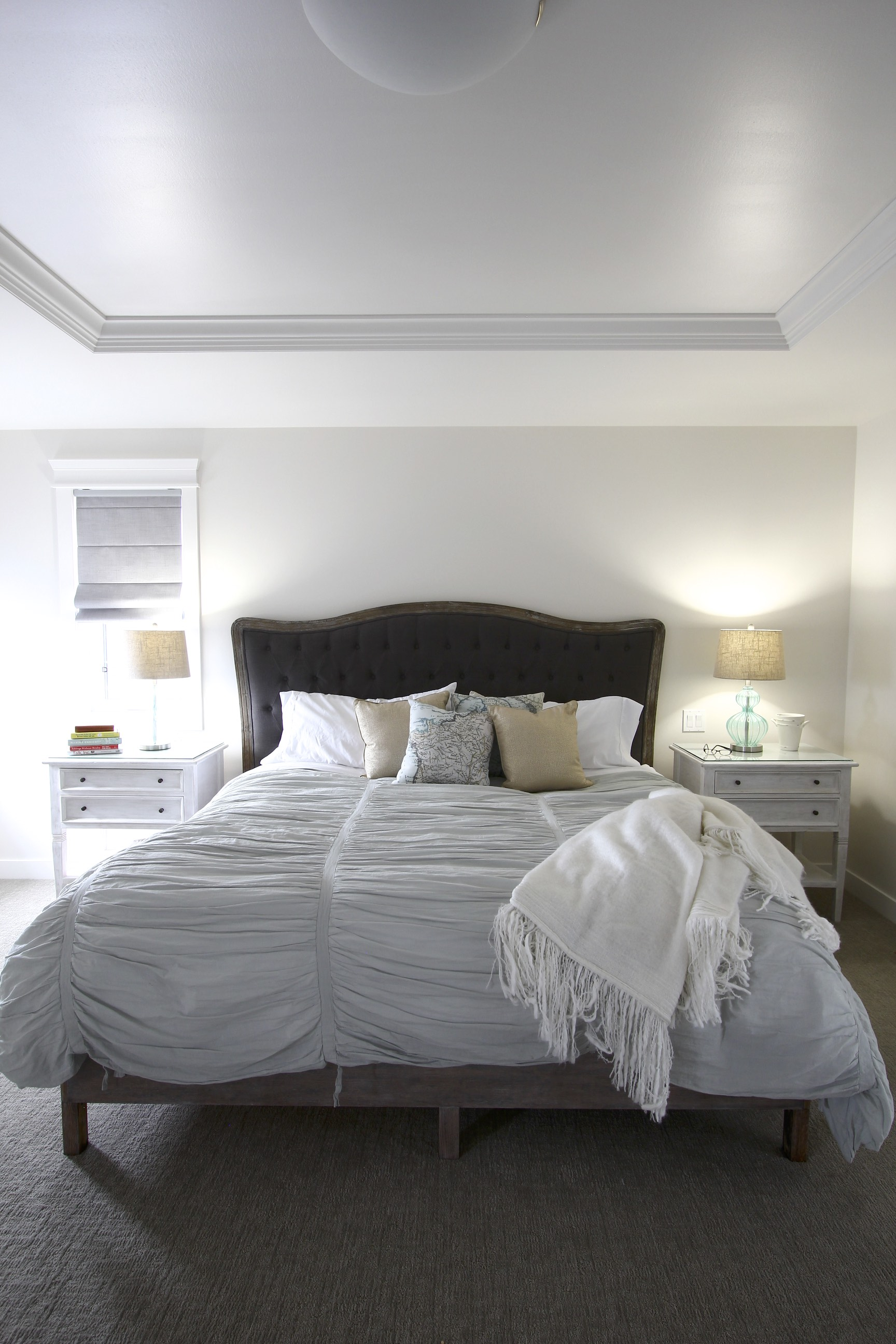 Metric Design Centre, Interior Design, Saskatoon, Residential Design, New Home Build, Transitional Design, Master Bedroom, Upholstered Bedframe, White Nightstands, Teal Glass Lamp, Bedding, Accent Pillows, Serene Bedroom, White Throw, Recessed Ceiling.jpg
