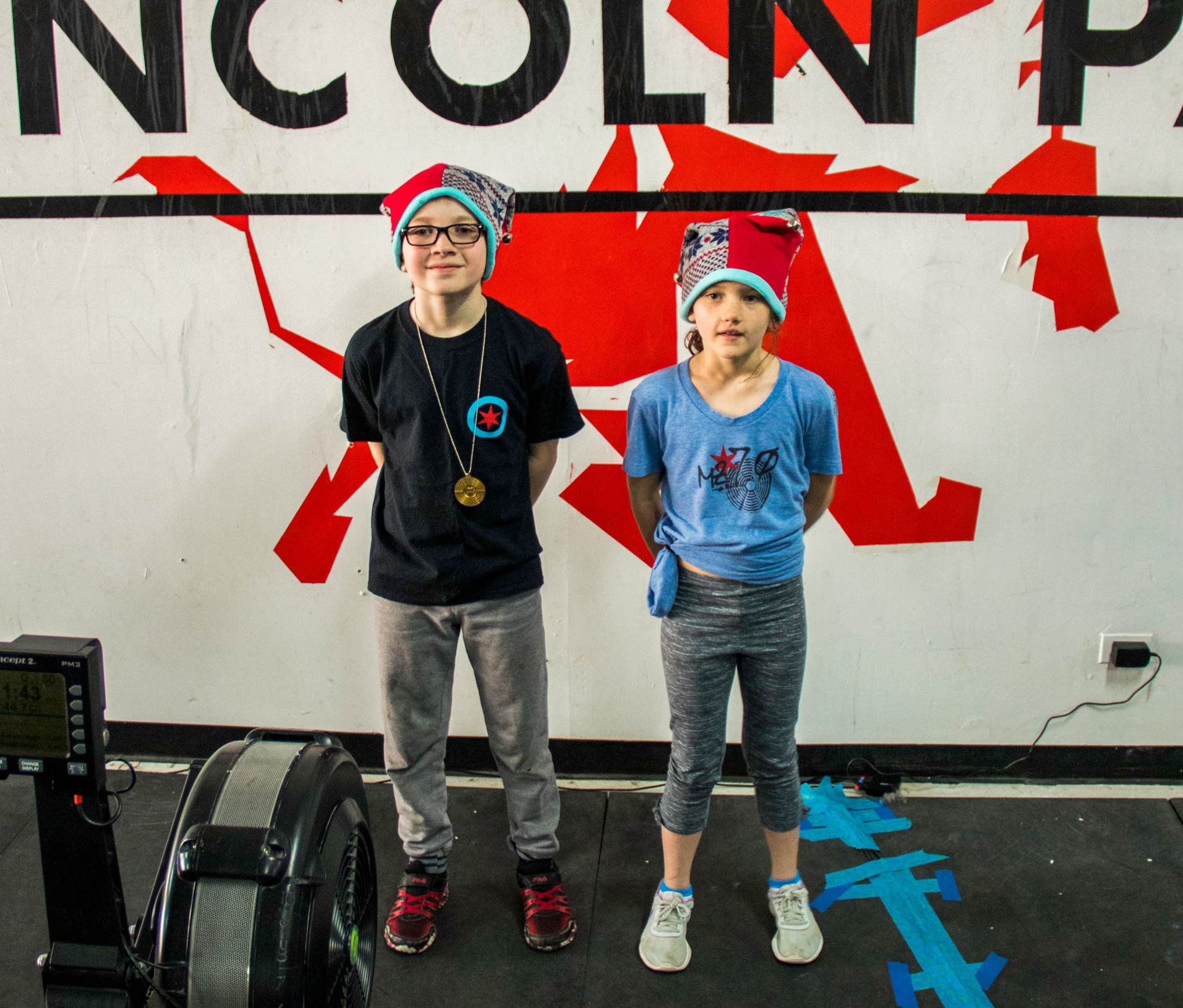 Aiden-Claire-medals-hats.jpg