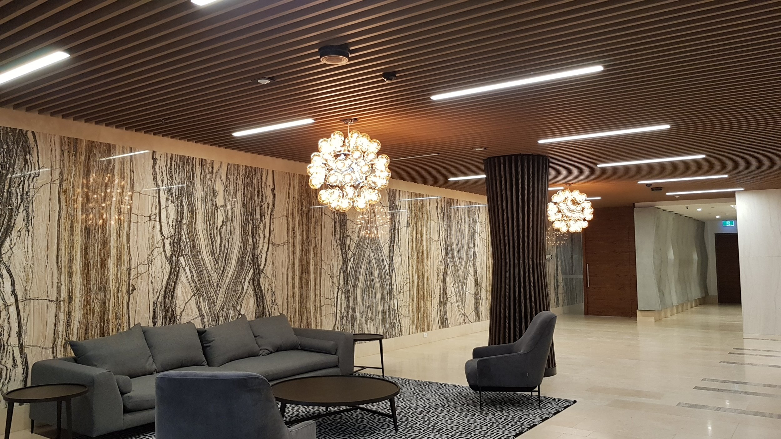 Lakeside Apartments Suspended Ceiling - Melbourne VIC Ever Art Wood® battens - Kabebari 30x85 in Kuri Masame; Custom powdercoated T section in Black