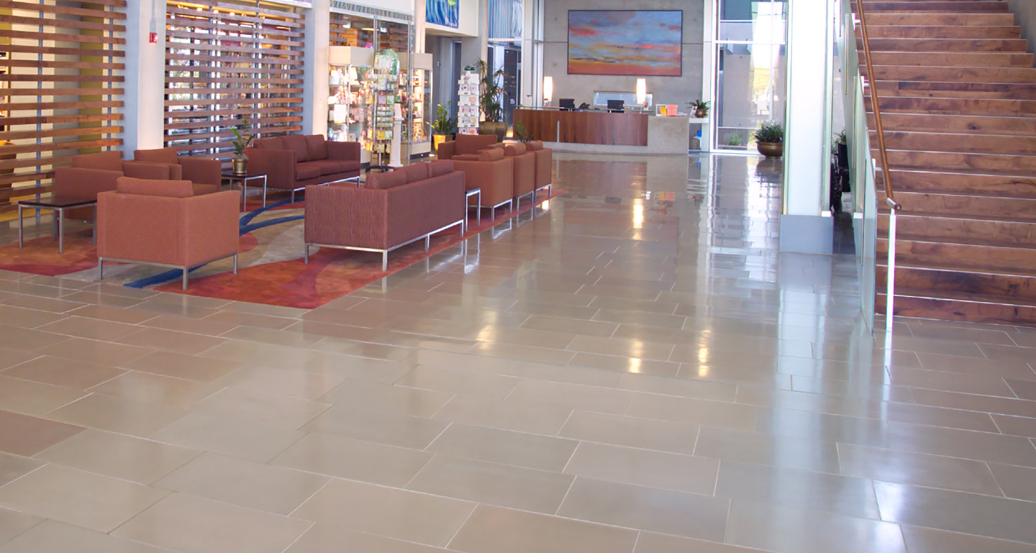 Interior concrete tile Commercial Banner Estrella Medical Centre Laguna Smooth Taupe and Olive 608x405 W.jpg