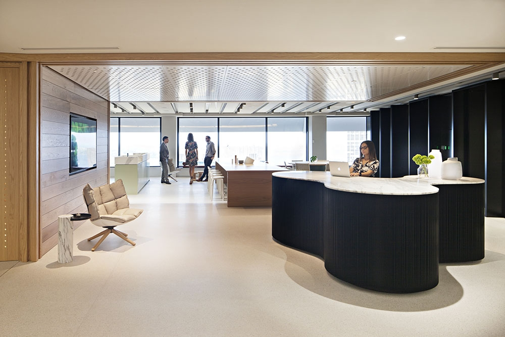 Unispace-GeorgeSt-Concrete-Overlay-Pietra-Dove_Reception.jpg