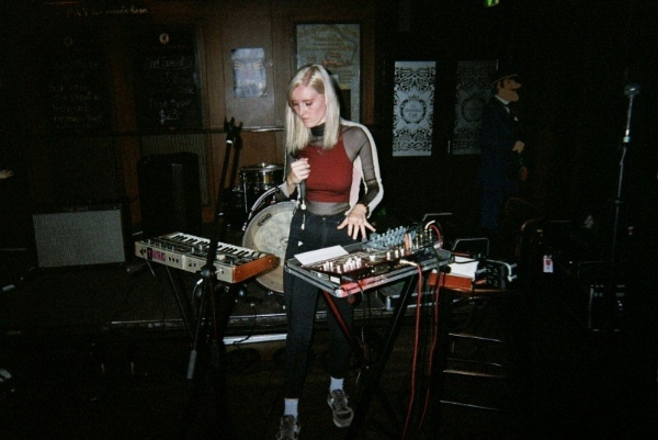 REBEL YELL  - a Brisbane based solo artist that also goes by the name Grace Stevenson - has been releasing confronting electronic music that's painted with heavy lashings of industrial and techno styles since 2016. Armed with a synthesiser, vocal processor, Metal Zone pedal, and various other dark tech armaments, Rebel Yell enforces driving EBM bangers that bring her authority home, while also not being afraid to elevate to a higher sphere. 'Hired Muscle', the forthcoming debut album, is out this June on the revered Rice Is Nice Records, but in in the meantime you can catch Rebel Yell live on all East Coast Youth Code shows.  Be hypnotized and slammed by the 'Pressure Drop' video right here .