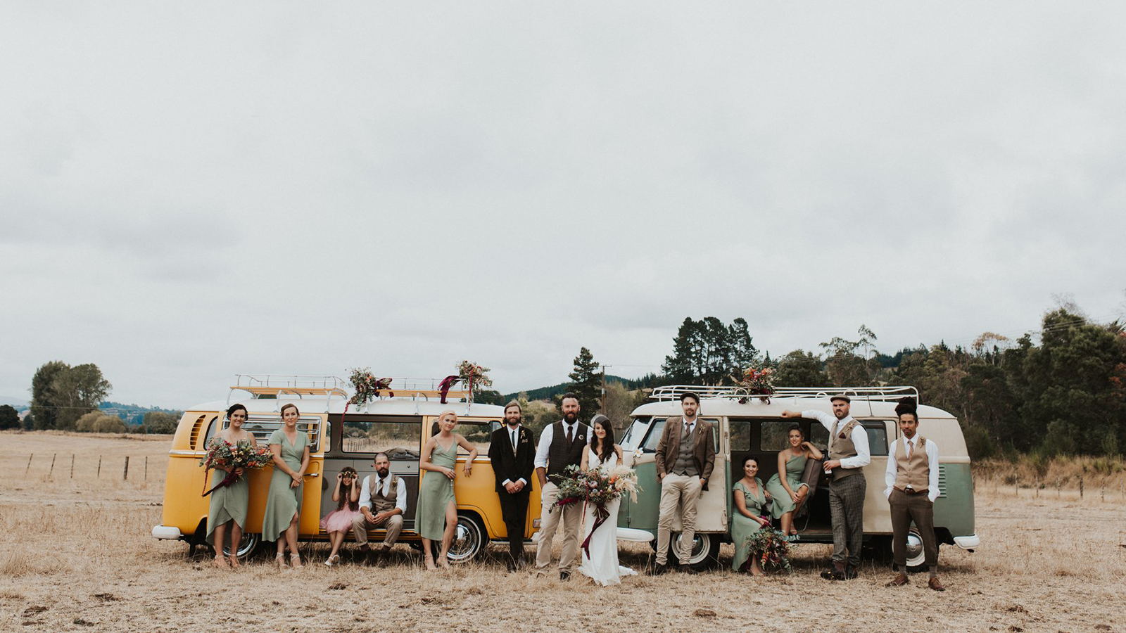 Emliy Rae Wedding Bridal Pary In Front Of Vintage Bus 1600pxW 16x9.png
