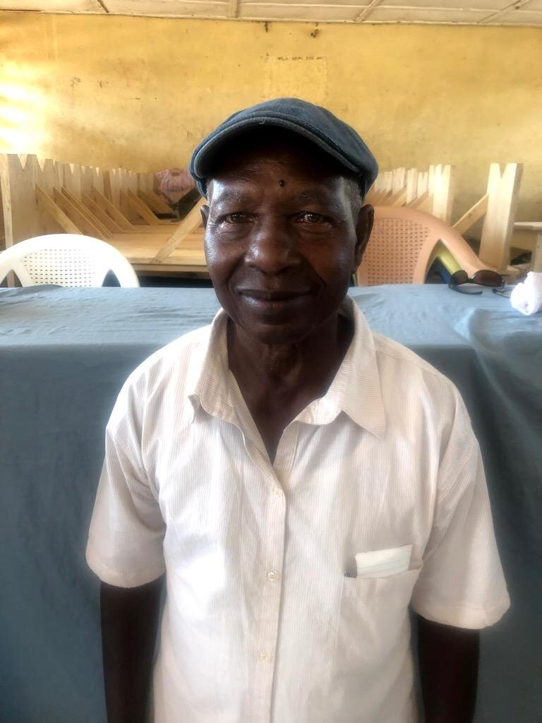 Sahr Edward Yambasu - Sahr Edward Yambasu was born and raised in Yengema town in the Nimikor Cheifdom, Kono, Sierra Leone. He started serving from 2009 – to present as the secretary for Kaimba Board of Directors in Sierra Leone. He is a career storekeeper who served from 1966 – 1992 as a store clerk for the Sierra Leone Selection Trust Ltd (SLST), a Diamond Mining Company which later become the National Diamond Mining Company (NDMC).