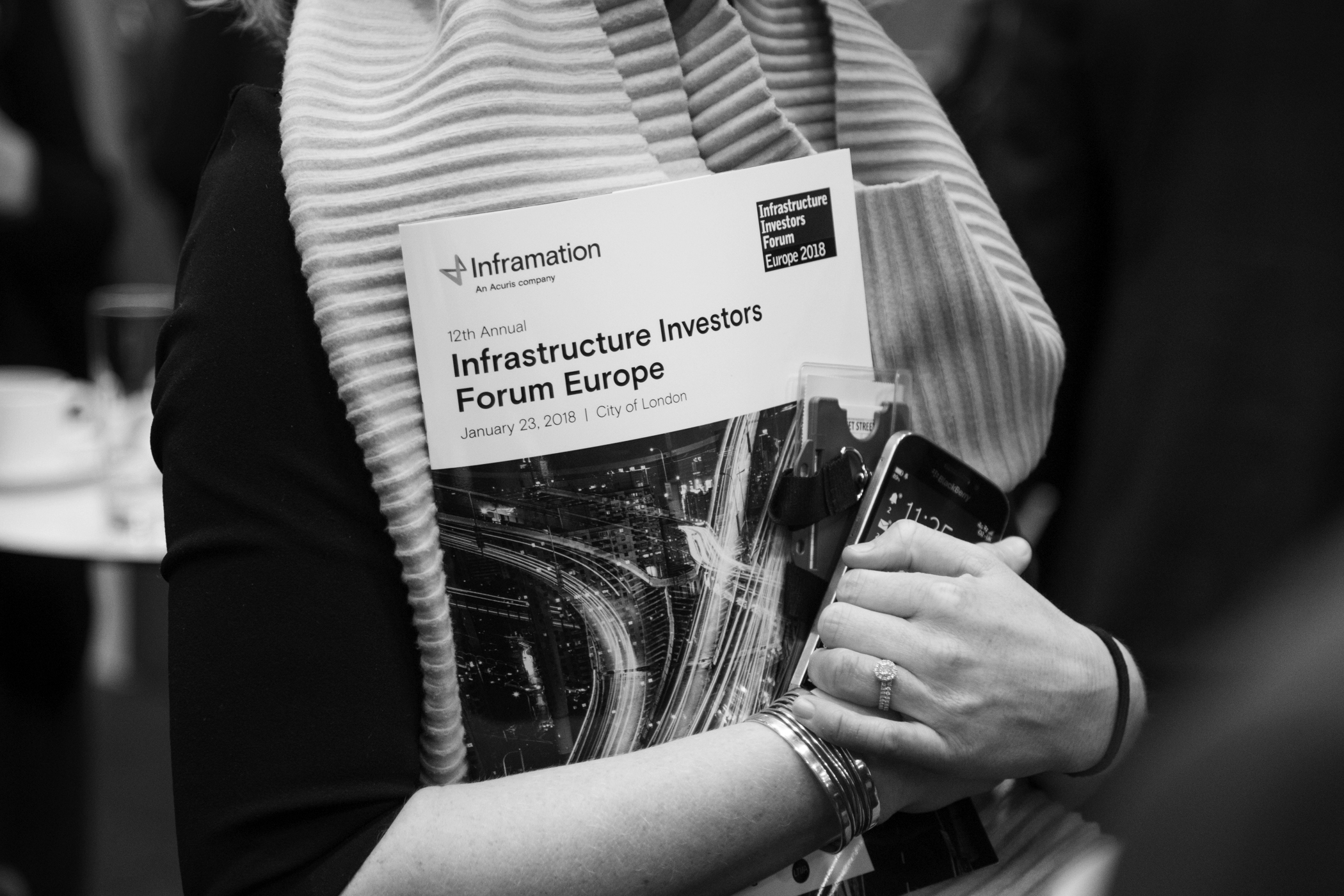 Woman holds conference booklet