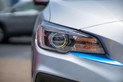Car HID headlight installation at Audio Realm.