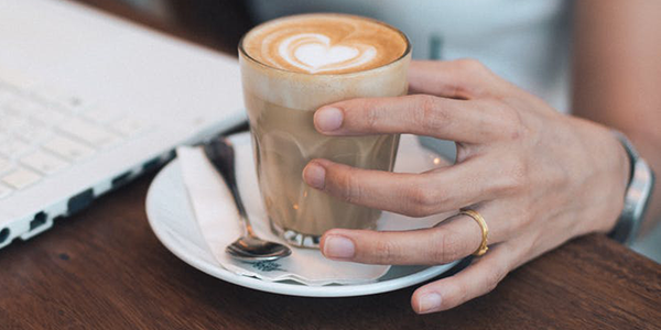 Woman-Holding-Coffee.png