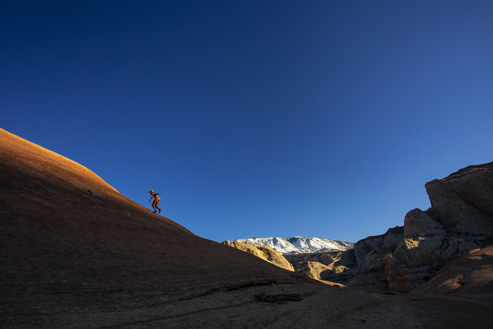 Exploring the expanse of slick rock domes near the Rainbow Trail. Photo by Stephen Eginoire