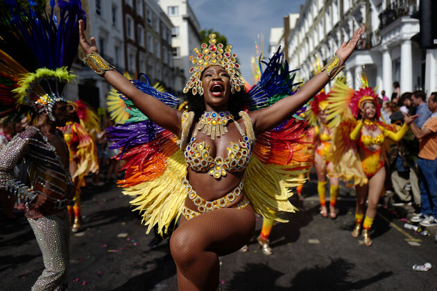Carnival performers participate in the parade on the main day of the Notting Hill Carnival in west London on August 28, 2017.  Nearly one million people are expected by the organizers Sunday and Monday in the streets of west London's Notting Hill to celebrate Caribbean culture at a carnival considered the largest street demonstration in Europe. / AFP PHOTO / Tolga AKMEN        (Photo credit should read TOLGA AKMEN/AFP/Getty Images)
