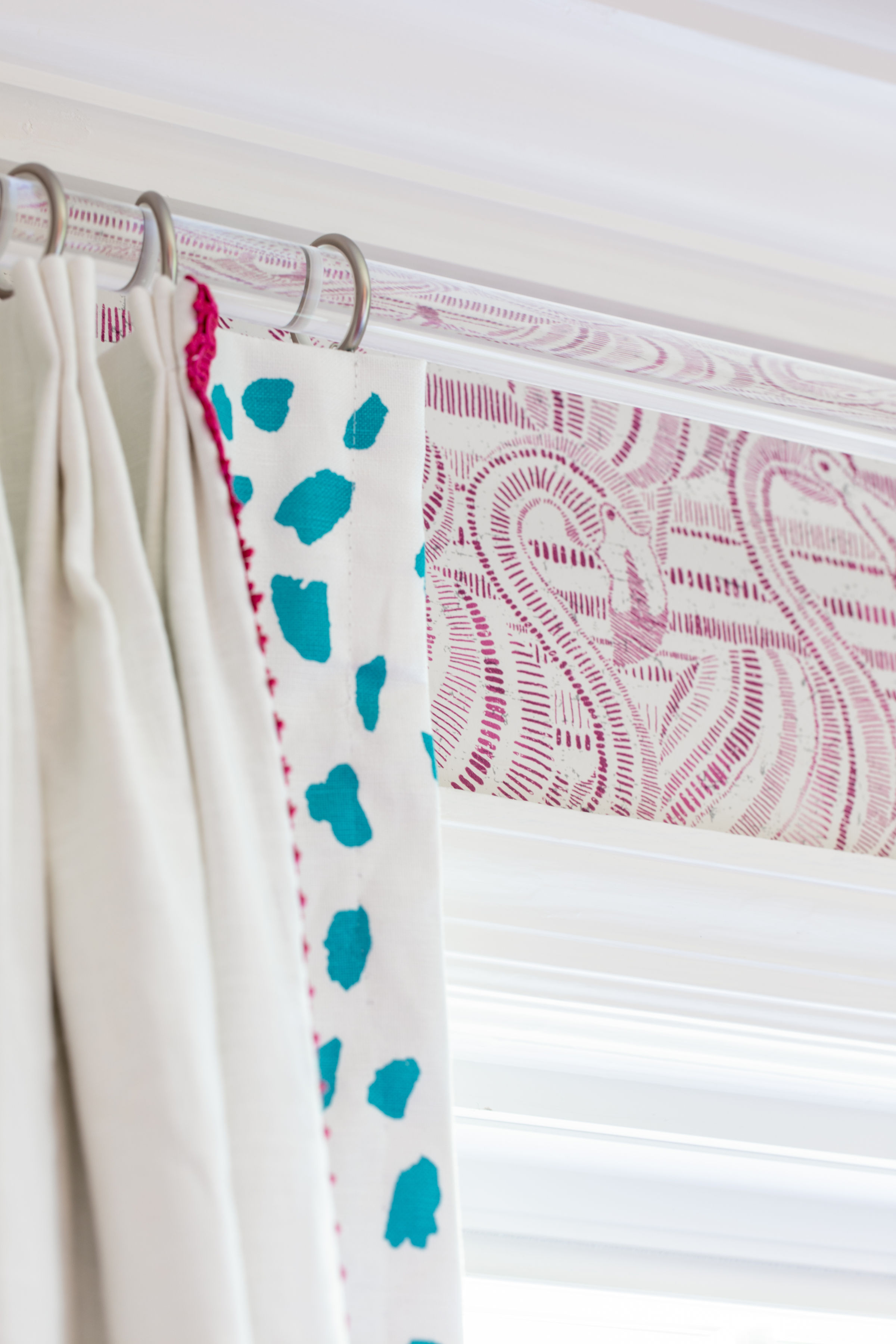 drapery detail with flamingo wallpaper