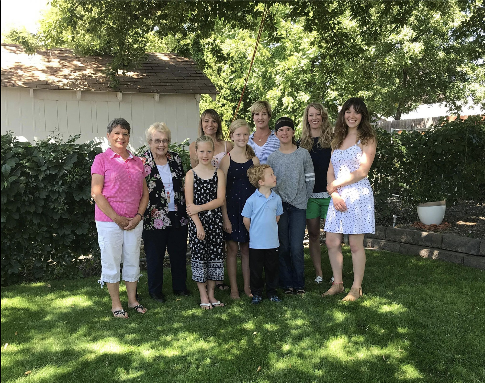 There are 4 generations in this photo! Me and my 2 sisters, our Mom, our grandmother, my 3 children and my sister's 2 children.