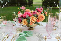wedding reception table with scabiosa, roses, peonies, protea, dahlia and eucalyptus.
