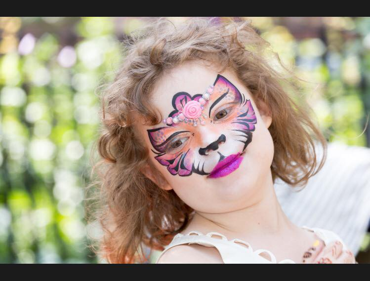 Super cute face paint of a princess tiger with bling, beautiful face painting in New York City for kids!