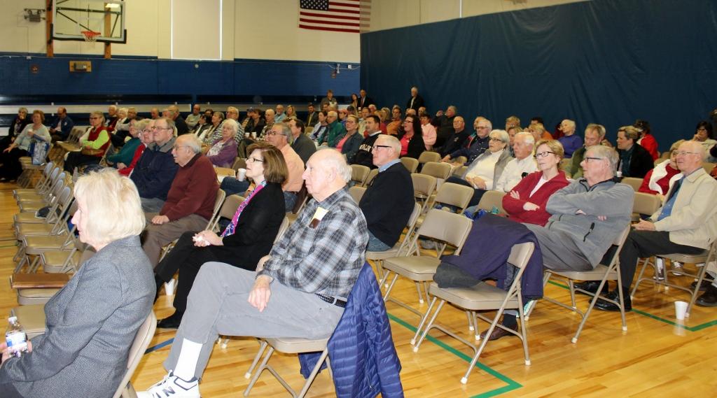 Crowd-listens-to-presentations-1024x569.jpg