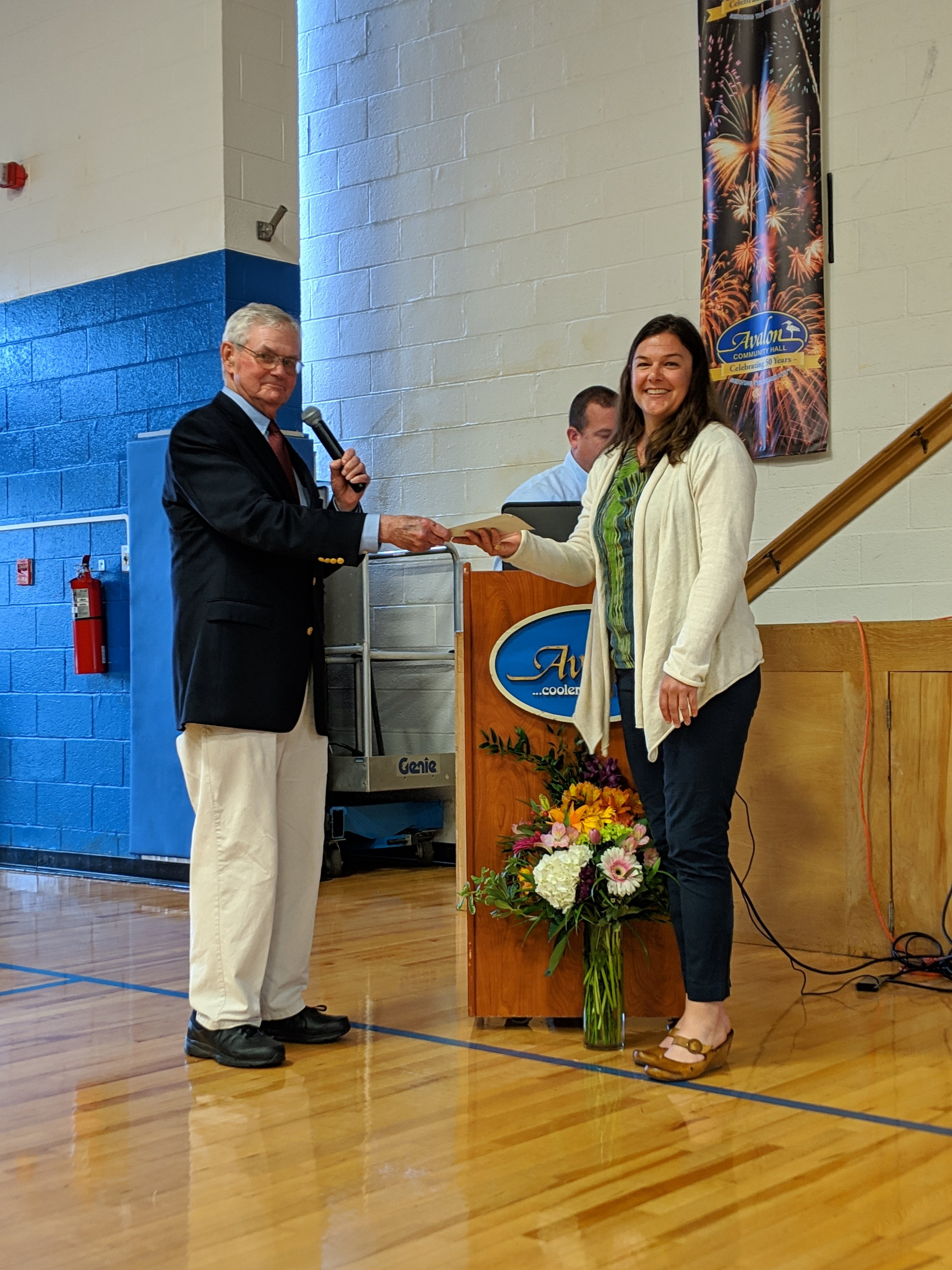Jack Keenan presents AHLOA donation to Dr. Lisa Ferguson, accepting on behalf of The Wetlands Institute