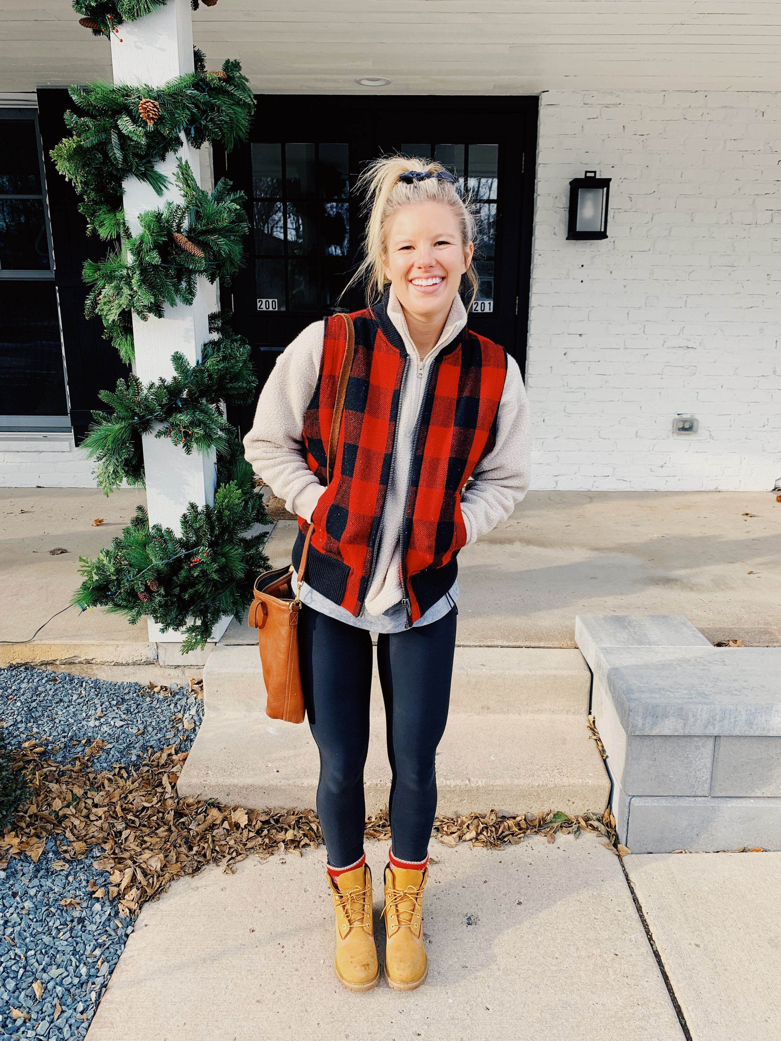 OUTFIT DETAILS:  Vest: Madewell, Quarter Zip:  Everlane , Leggings:  Spanx , Boots:  Timeberland , Purse:  Madewell