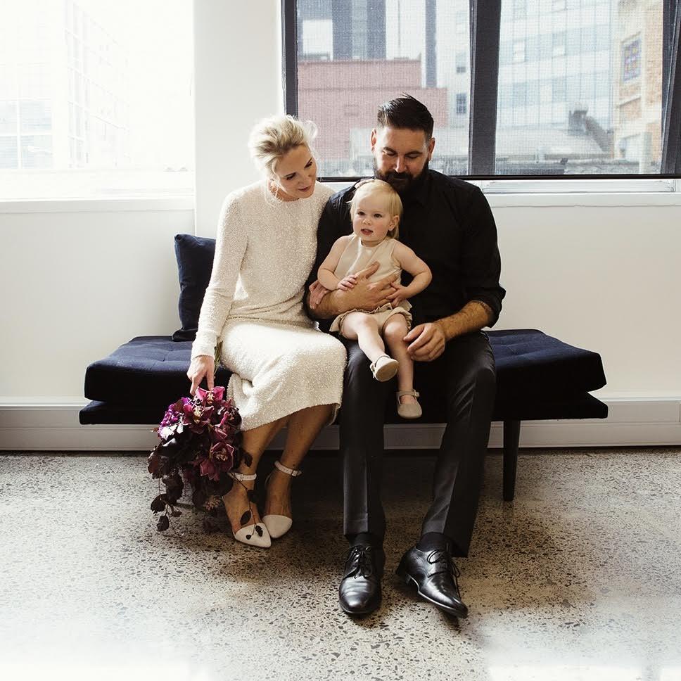 Juliette Hogan, Husband Dion and their Daughter on their wedding day  Image Olivia Hemus