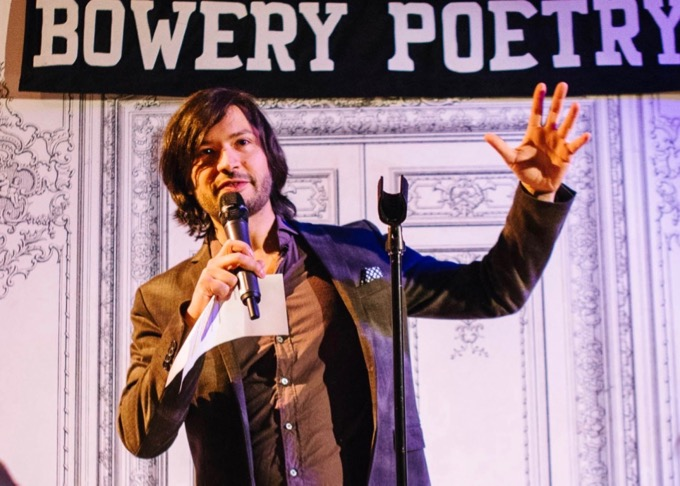 Nikhil Melnechuk on Stage at Bowery Poetry