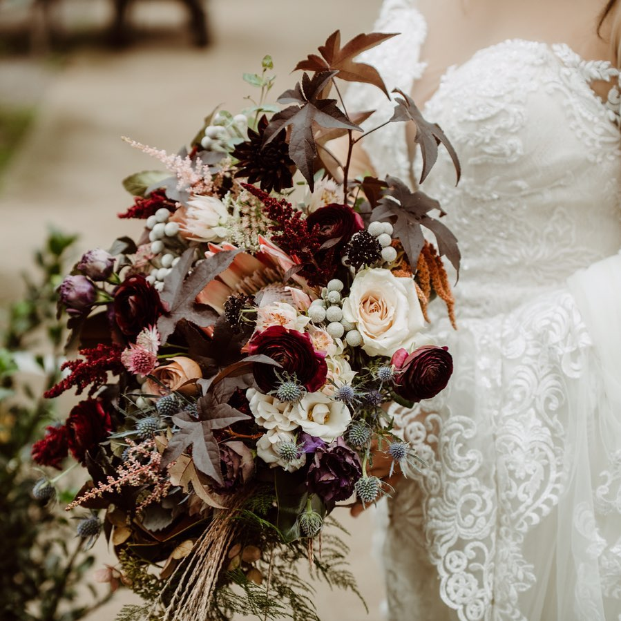 This beautiful bouquet is designed by  Bloom Flower Co. , located in Perkasie, Pa, and we love the dark soft hues. The contrast of these tones and the purity of a bridal gown will make you glow as you take steps toward your happily ever after.  Photographer:  Love Shack Photo
