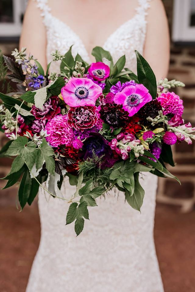 Don't let your fall colors fall flat. This bouquet designed by  Branches and Blooms Designs , located in Doylestown, Pa, will surprise your guests with an unexpected pop of purple on your perfect day!  Photographer:  Erin Joyce Photography