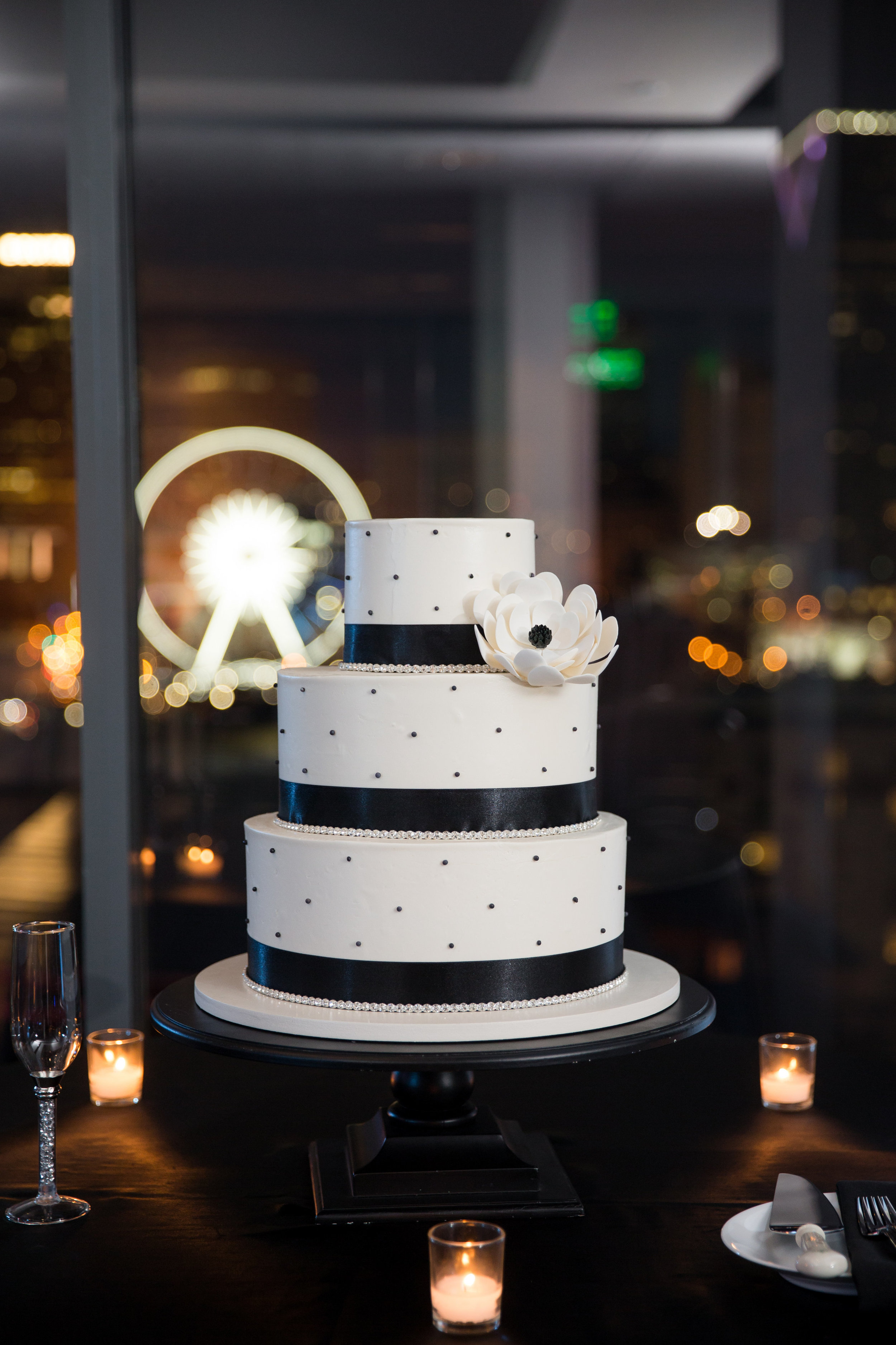 wedding - Black_Swiss_dots_and_black_ribbon_with_one_black_centered_flower_1.jpg