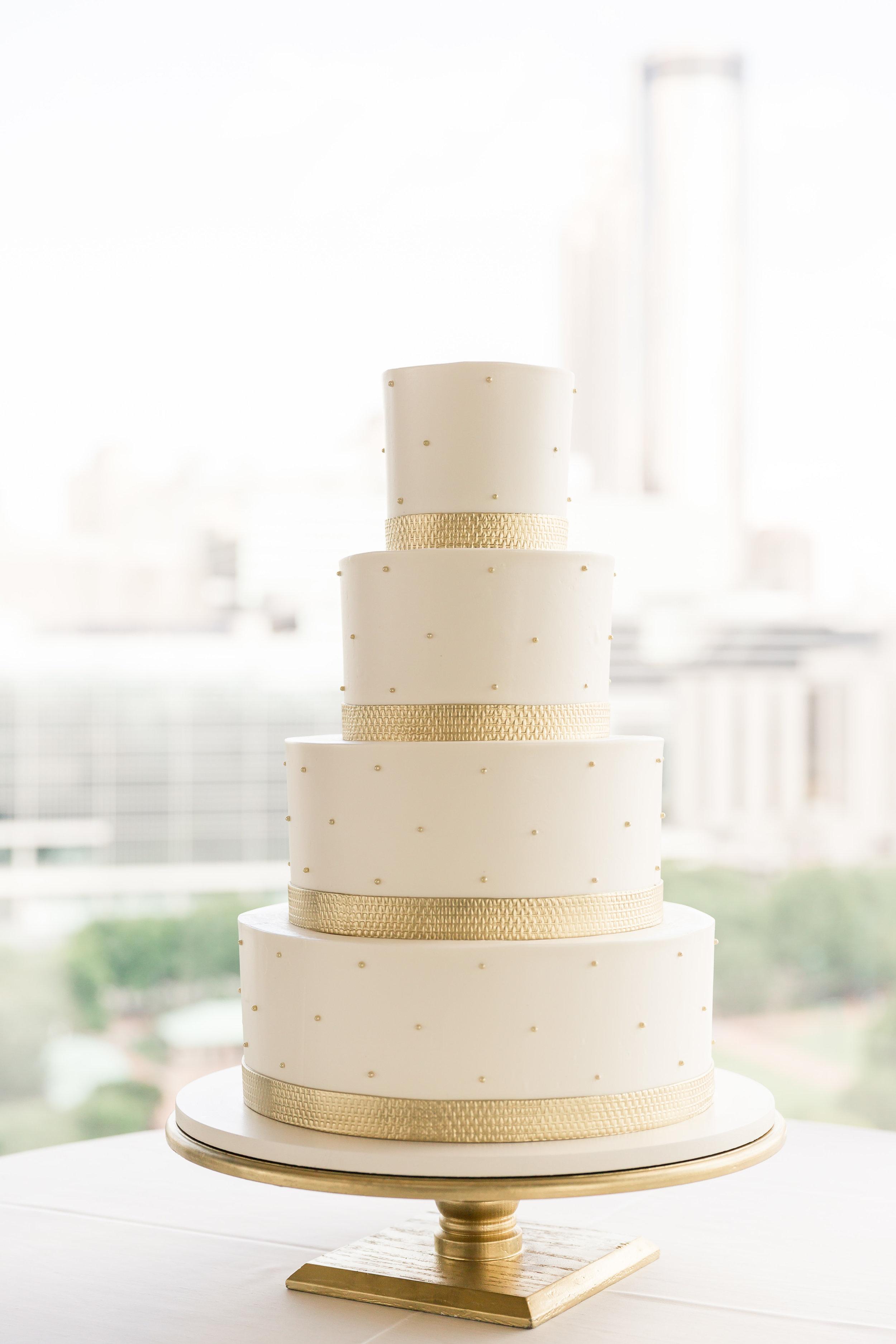 signature - Gold textured ribbon wedding cake.jpg