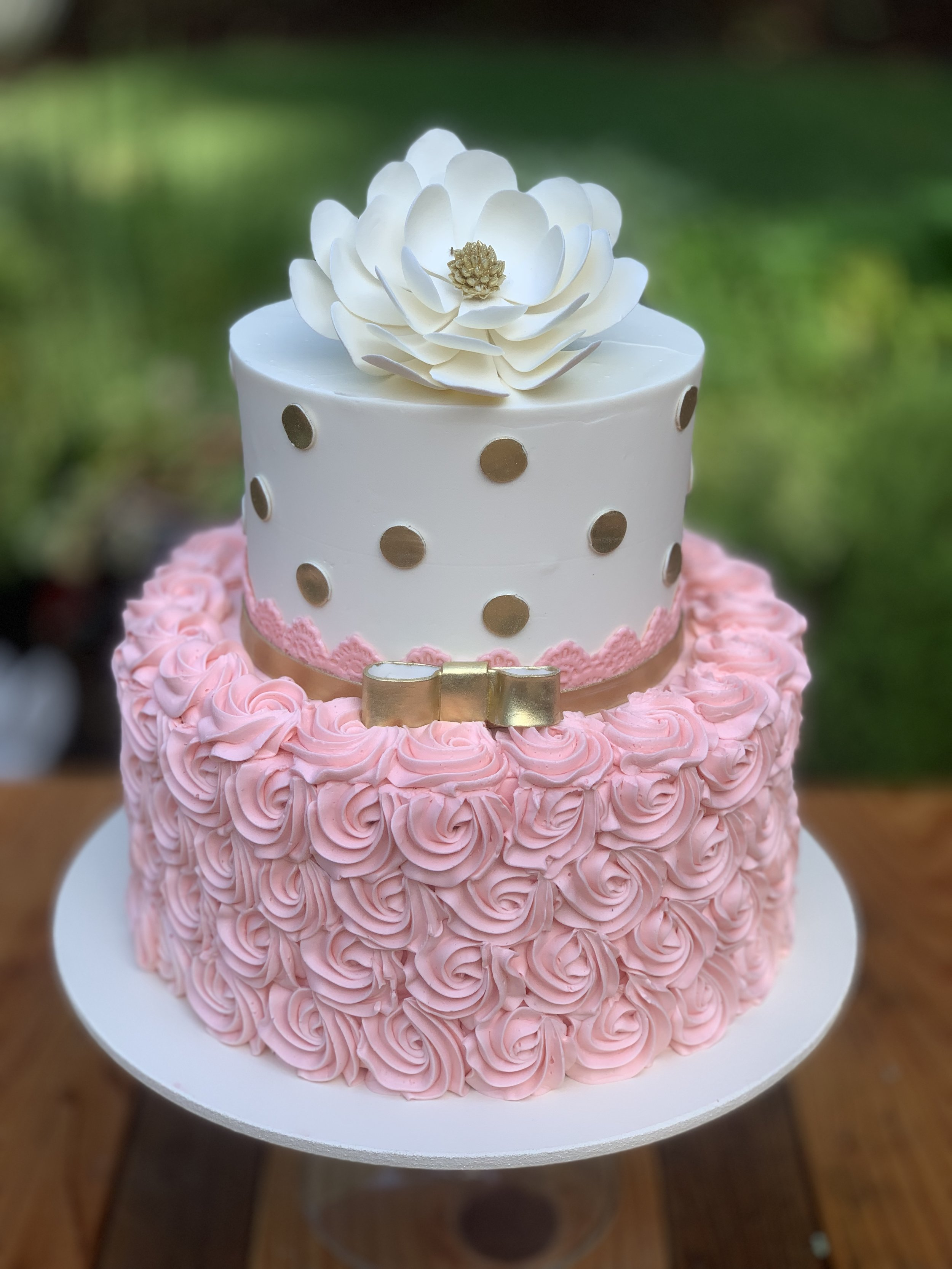 two tier cake with large flower.jpg