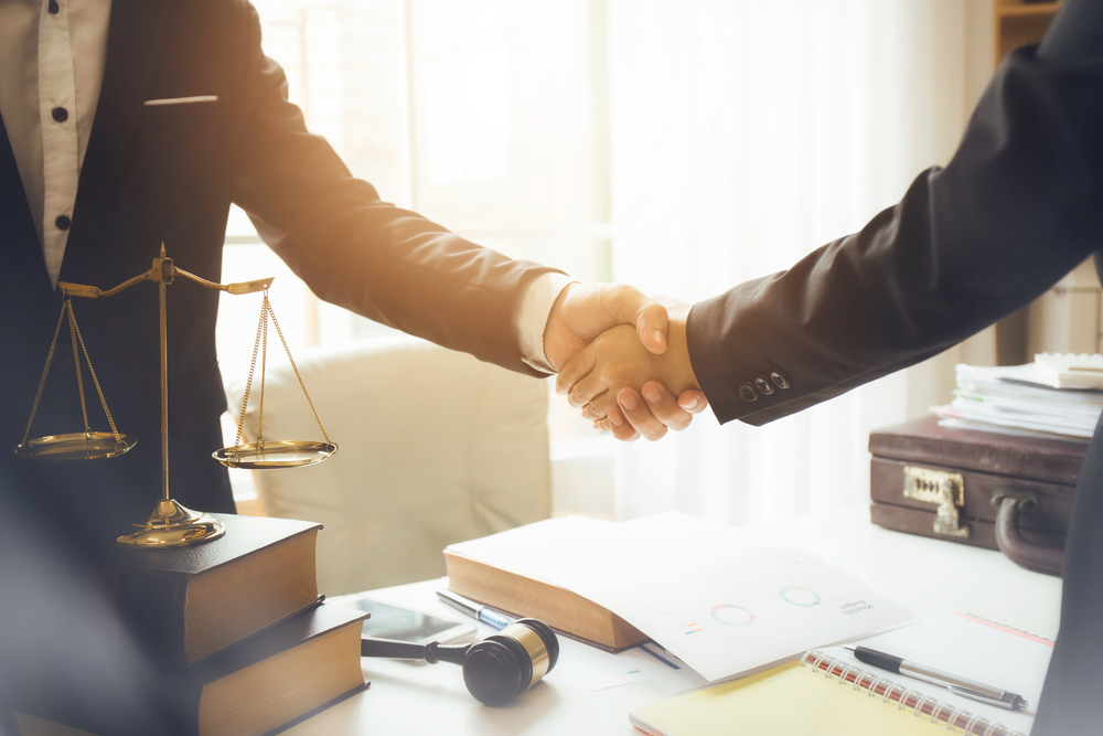 Lawyer and client shake hands
