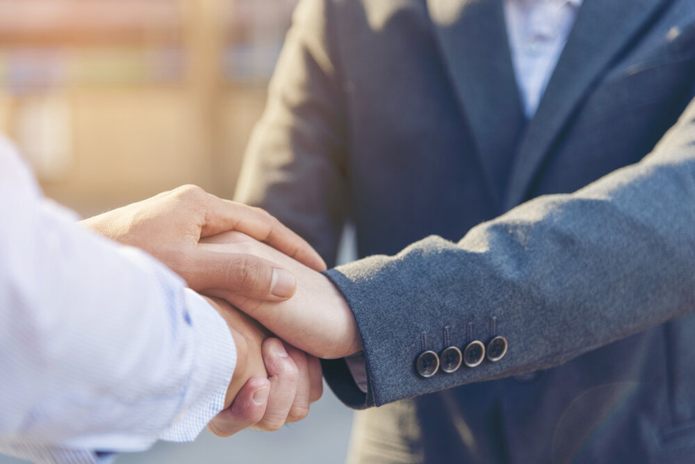 Lawyer shake hands with client