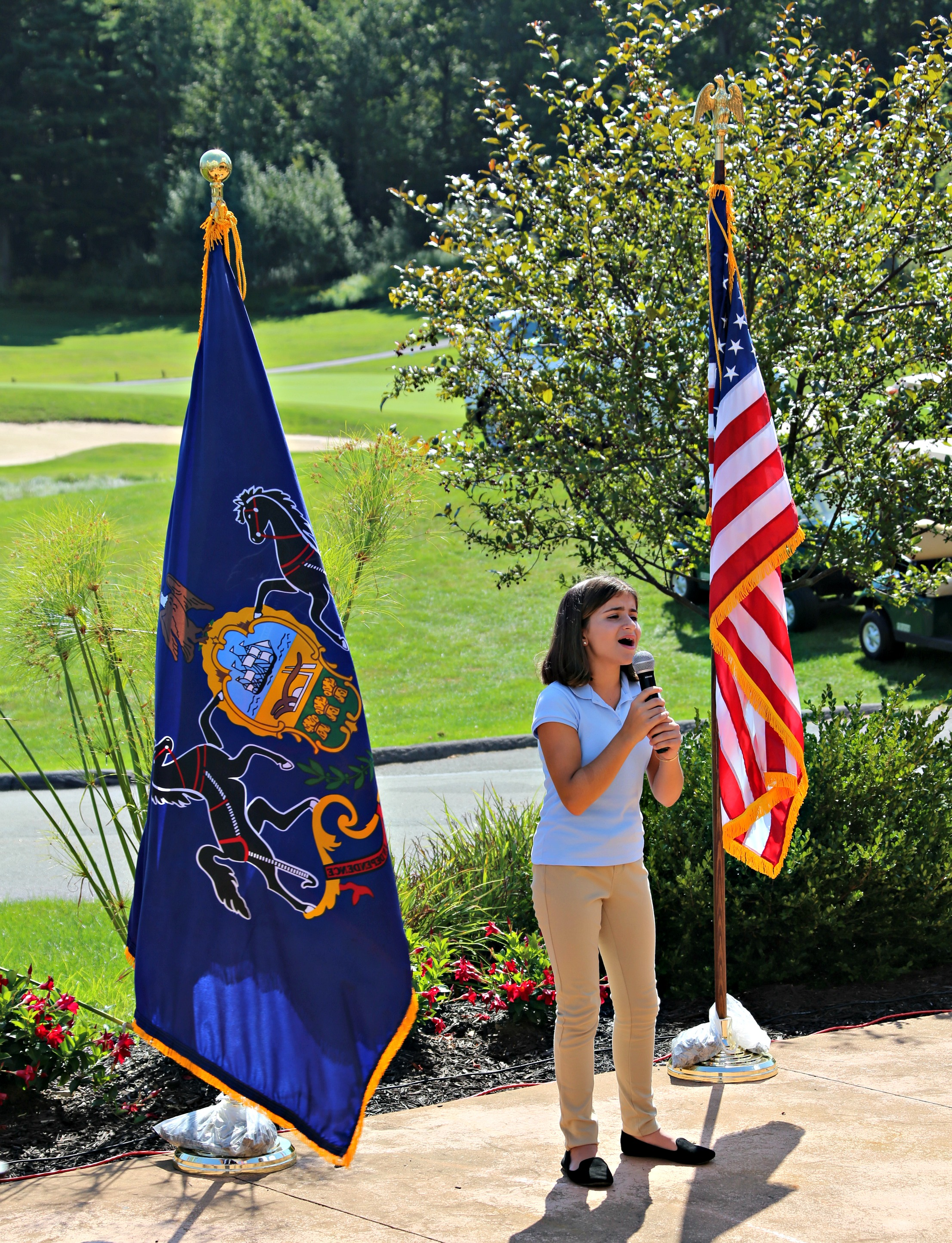 An amazingly talented local individual sings the National Anthem.