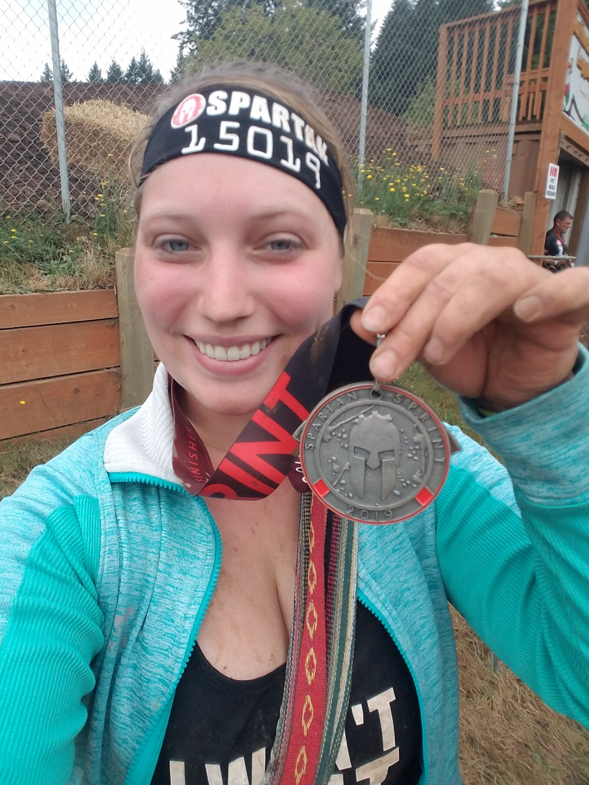 Mia after completing her first Spartan Race in August, 2019!