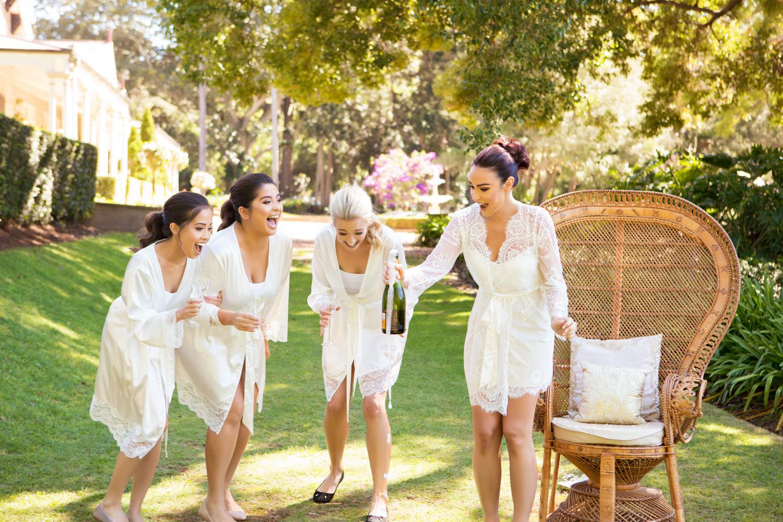 wedding-0017-dressinggown-champagne-bridesmaids-fun-bride-queensland.jpg