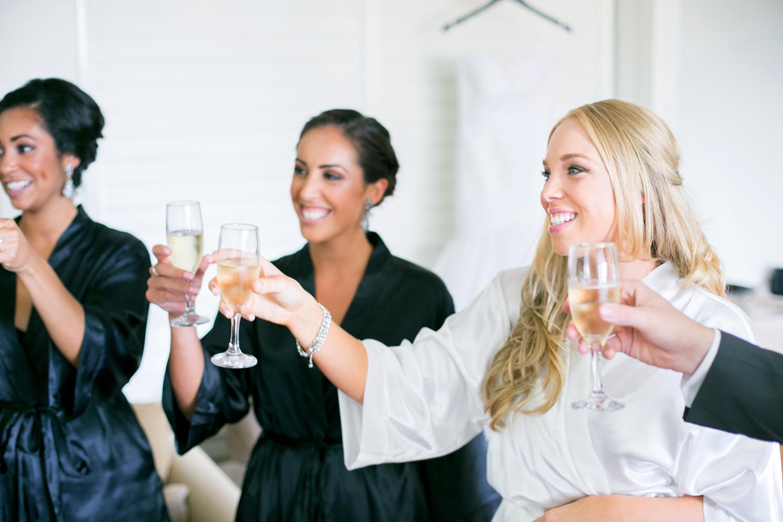 wedding-0254-cheers-dressinggown-bridesmaids-champagne-queensland.jpg