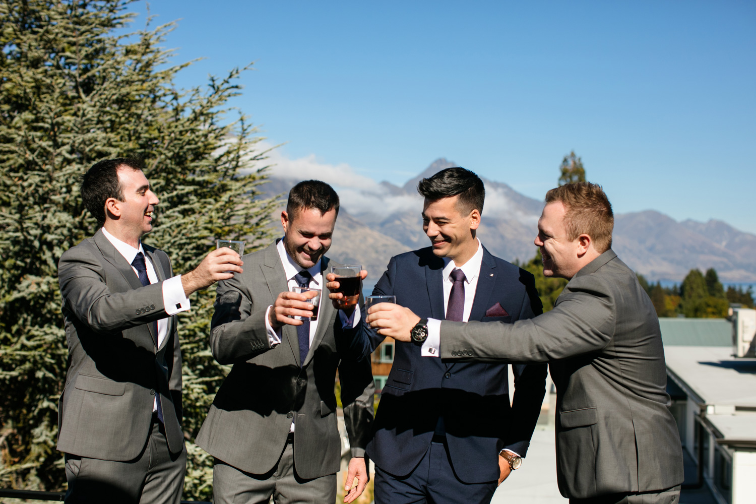 wedding-0310-drinks-cheers-view-blue-suit-brisbane.jpg