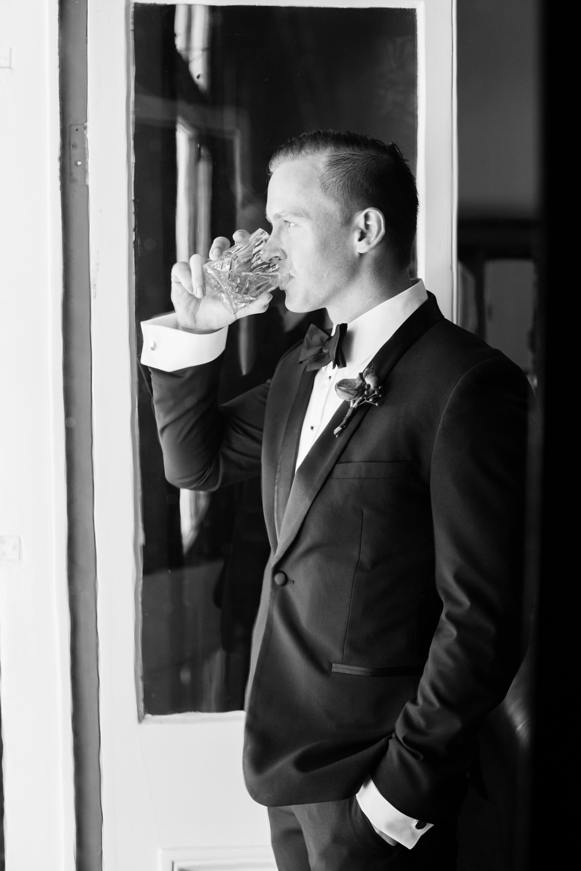 wedding-0038-bowtie-suit-groom-buttonhole-whisky-queensland.jpg