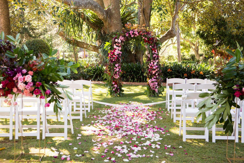 wedding-0040-ceremony-flowers-arch-garden-chairs-brisbane.jpg