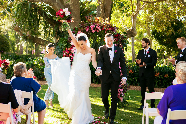 wedding-0051-ceremony-flowers-garden-arch-excited-australia.jpg