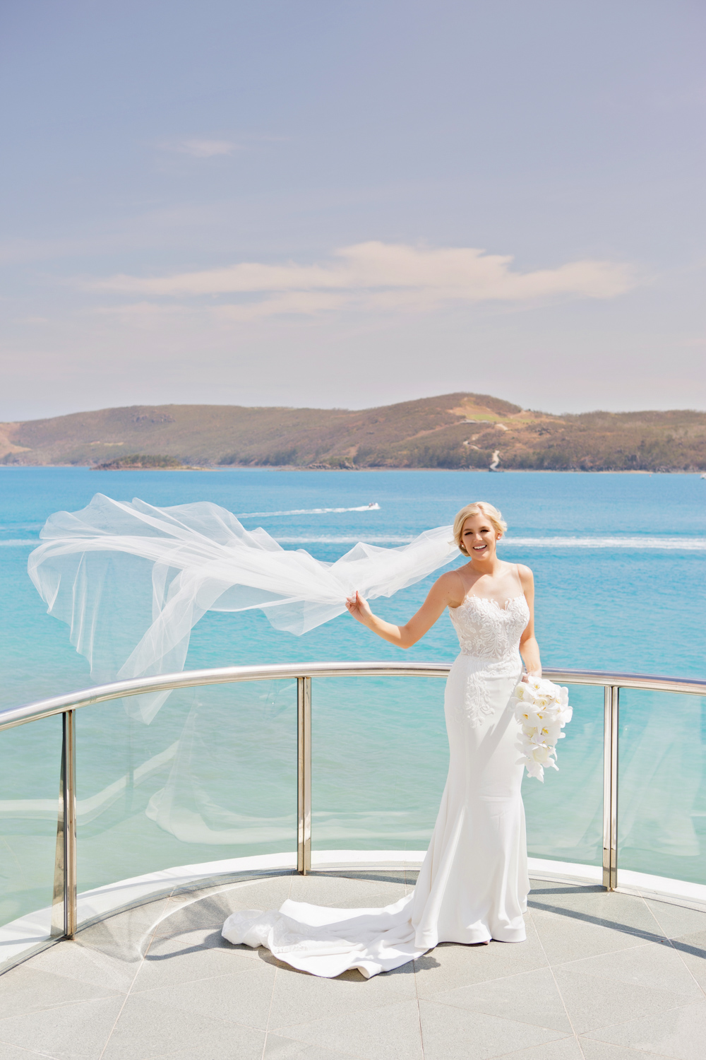 wedding-0133-yachtclub-veil-wind-happy-bride-brisbane.jpg