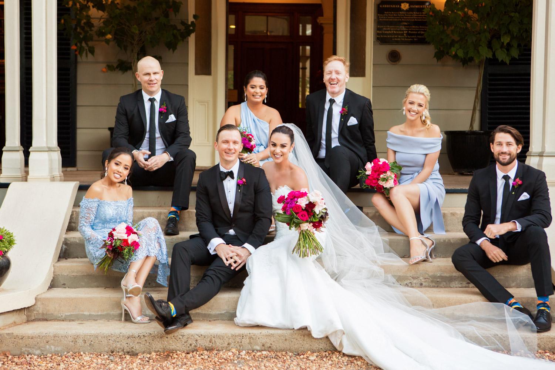 wedding-0064-bridalparty-laughter-joy-sitting-blue-brisbane.jpg