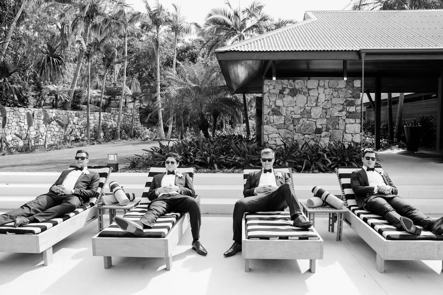 wedding-0141-qualia-boys-pool-groomsmen-bowtie-australia.jpg