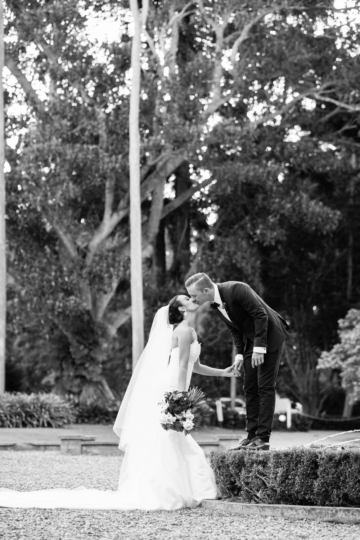 wedding-0065-kiss-fountain-bride-groom-trees-queensland.jpg