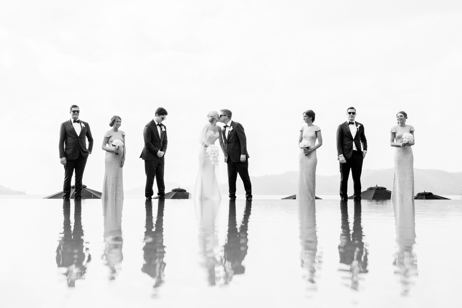 wedding-0143-qualia-pool-bridalparty-reflections-kiss-queensland.jpg