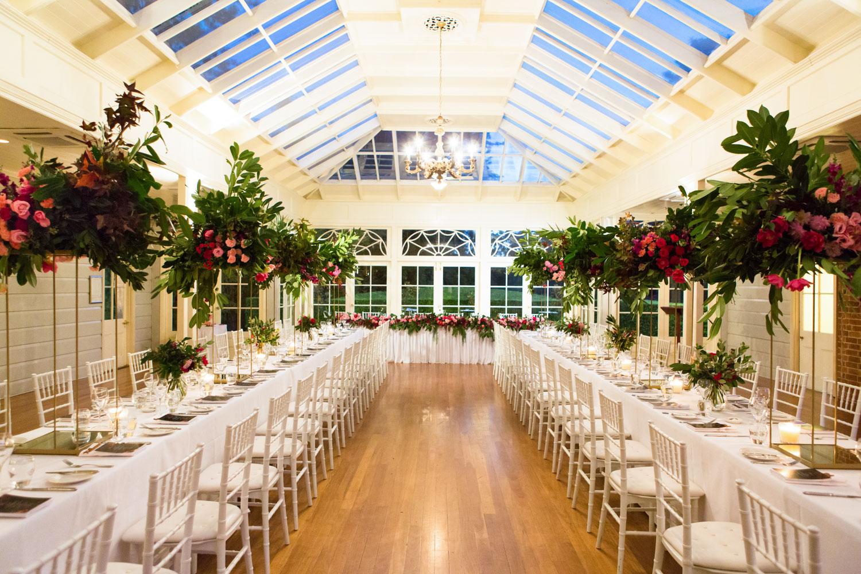 wedding-0078-reception-white-chairs-centrepieces-flowers-australia.jpg