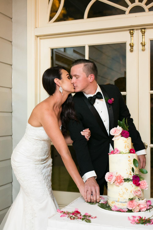 wedding-0091-cake-cutting-kiss-reception-pink-brisbane.jpg