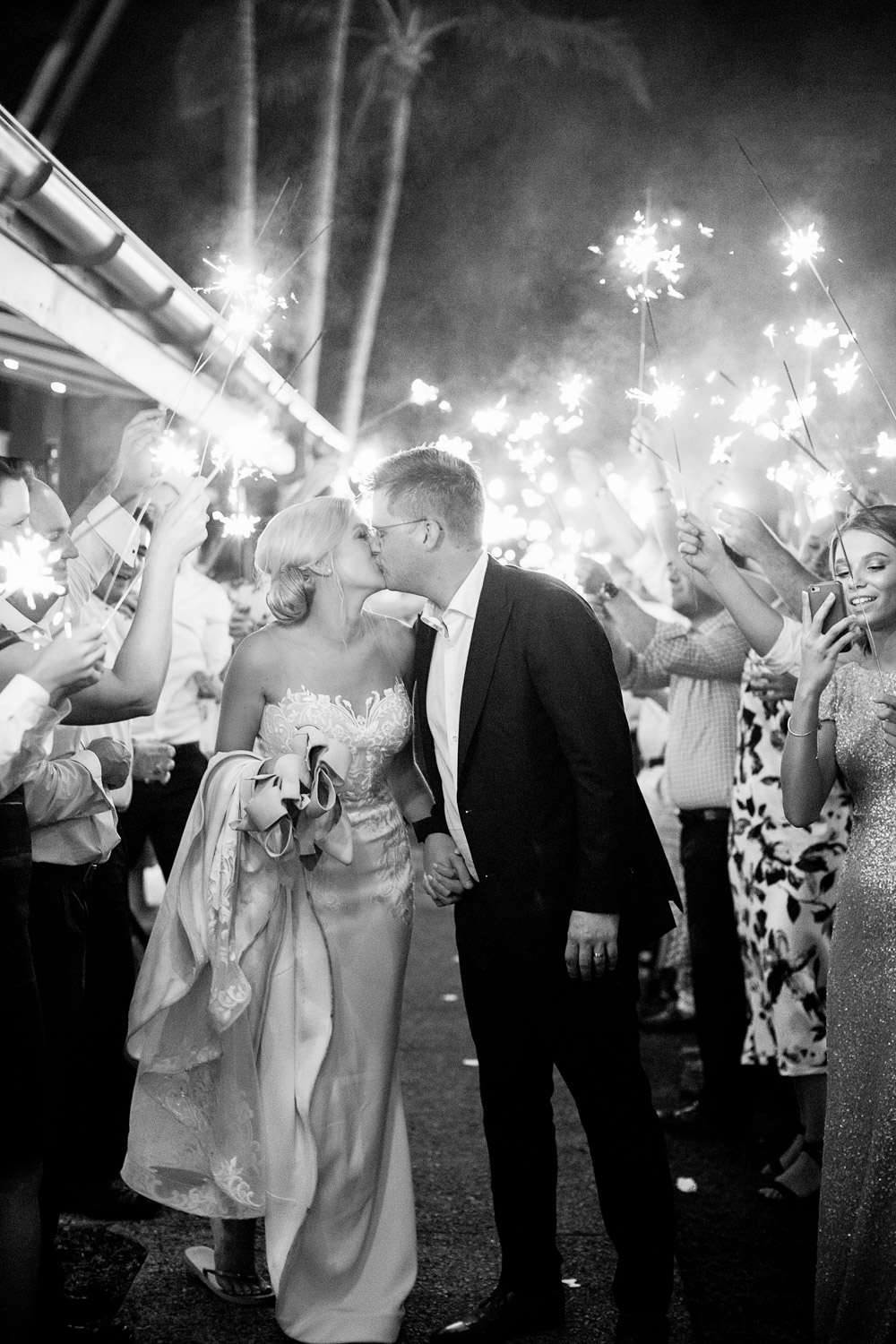wedding-0165-outrigger-reception-sparklers-kiss-romantic-australia.jpg