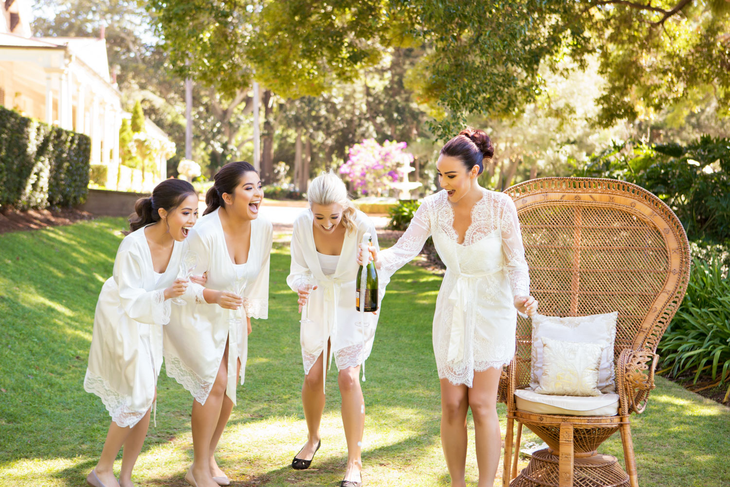 wedding-0407-bridesmaids-dressinggown-champagne-laughing-queensland.jpg
