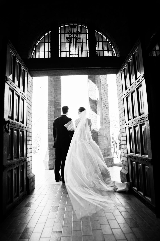 wedding-0578-stbridgets-redhill-veil-doorway-queensland.jpg