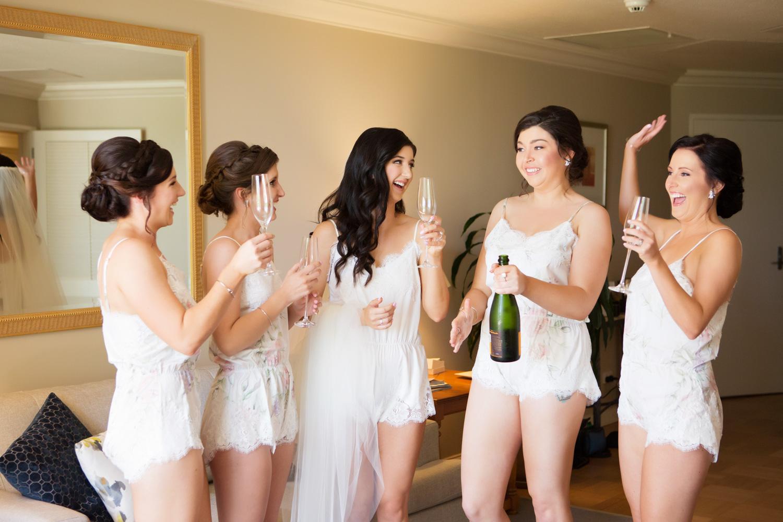 wedding-0518-bridesmaids-fun-toast-champagne-queensland.jpg